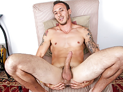 horny muscly guy with tattoos jerks off his stupendous big jock
