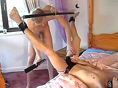 Chained gay slave getting screwed