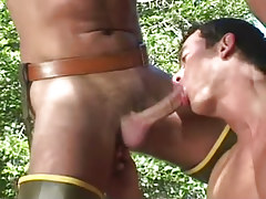 Horny gay dude sucks stick in nature