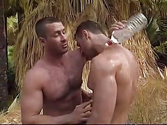 Muscle man-lover dilfs caress each other in jungle